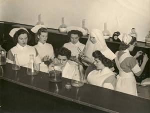 Nurses in training with a Sister at St. Joseph's School of Nursing.  Courtesy of the RHSJ St. Joseph Regional Archives