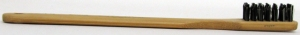 A wood-handled, synthetic bristle toothbrush (circa 1935-1945) made in Japan. Museum of Health Care # 010020498