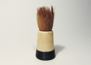 "A shaving brush dating to the nineteenth century. The brush pictured here is made of ""pure badger hair"" as indicated on its handle. Museum of Health Care #1980.18.115"