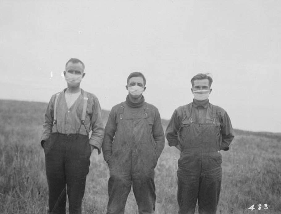 Men wearing masks during the Spanish Influenza epidemic, circa 1918.